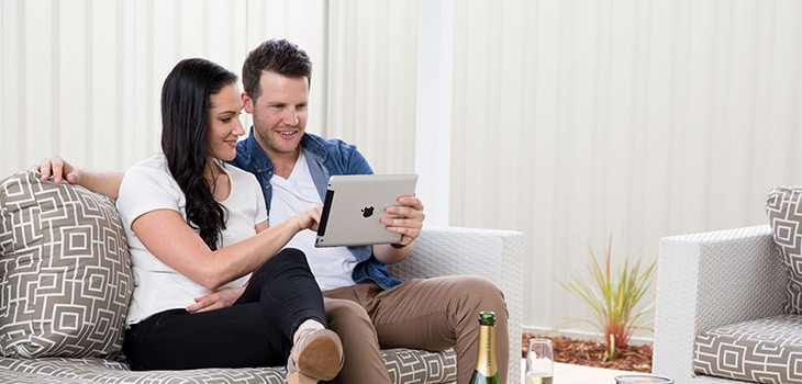 A young couple researches before buying their first home.