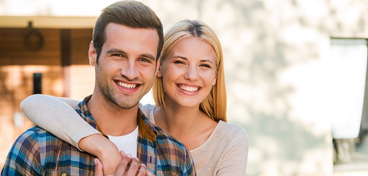 A happy first home buyer couple